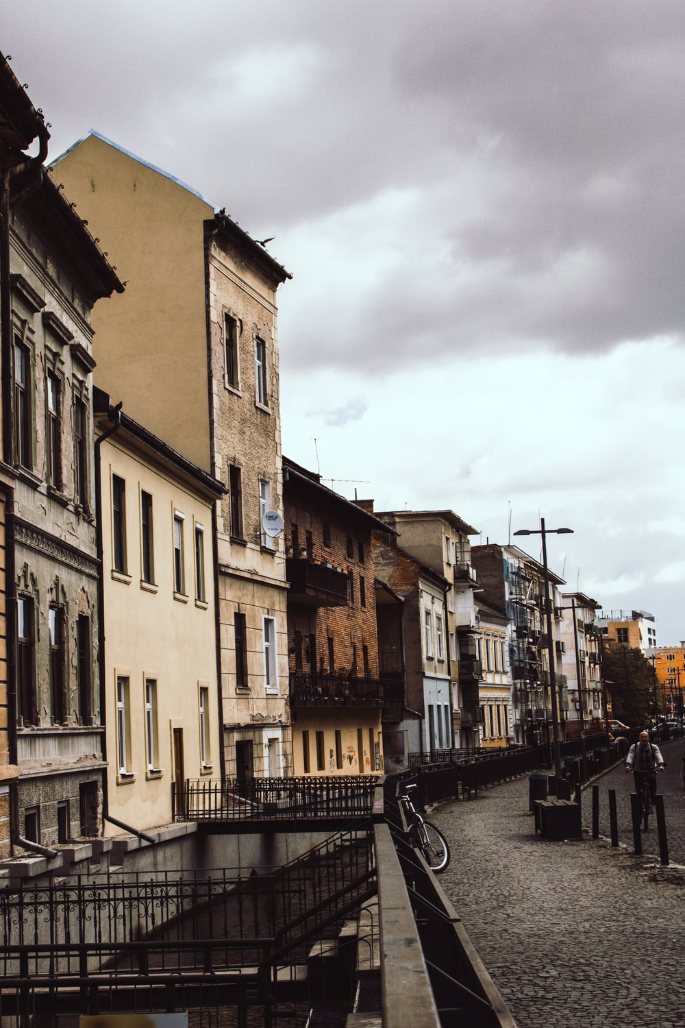 brown buildings under white clouds