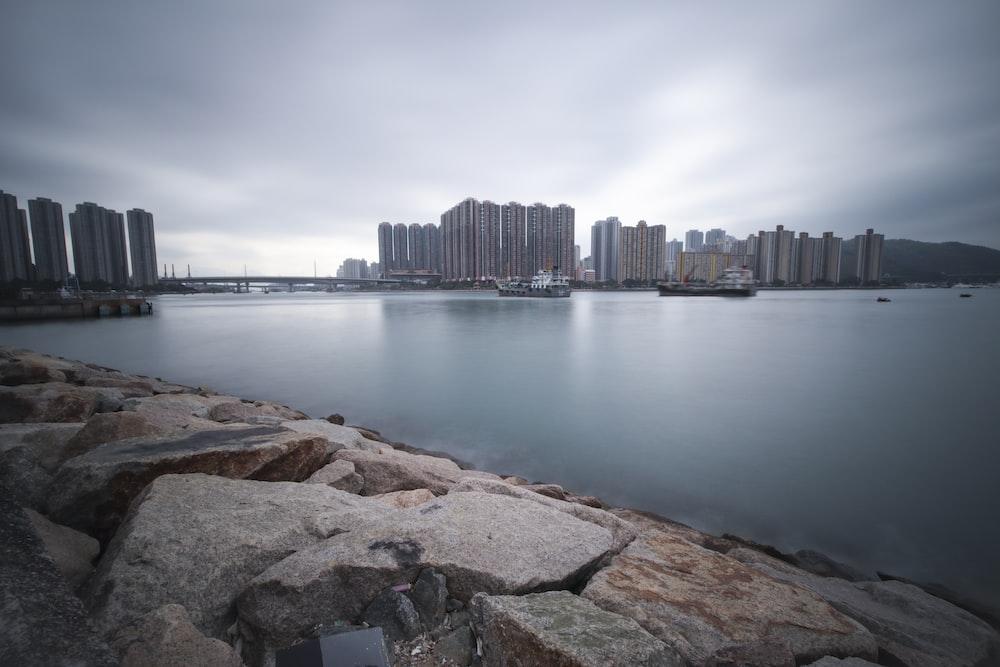 city buildings beside body of water