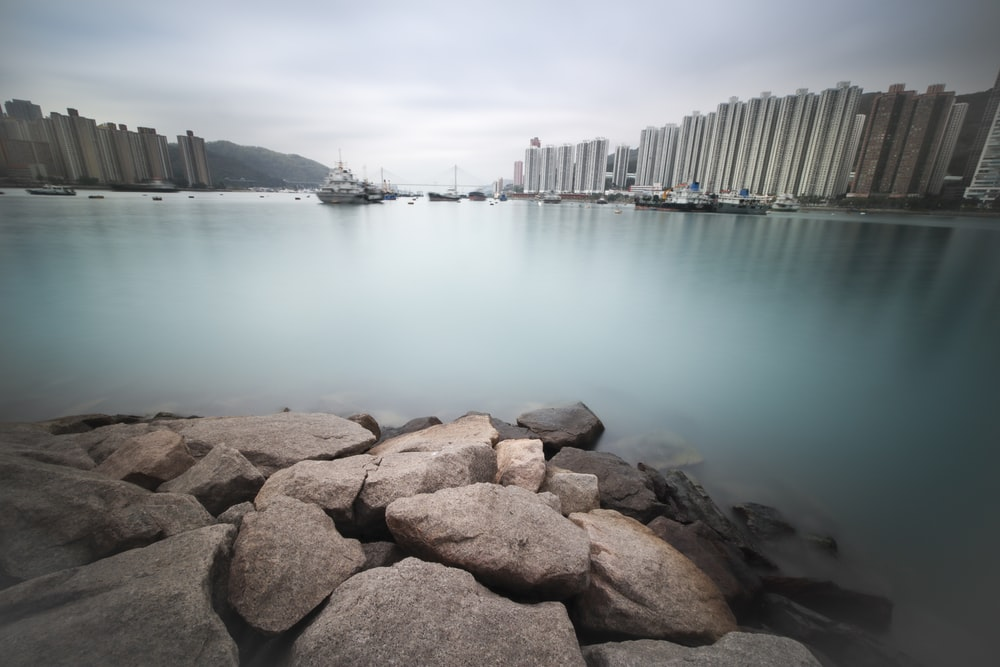 blue body of water beside high-rise building