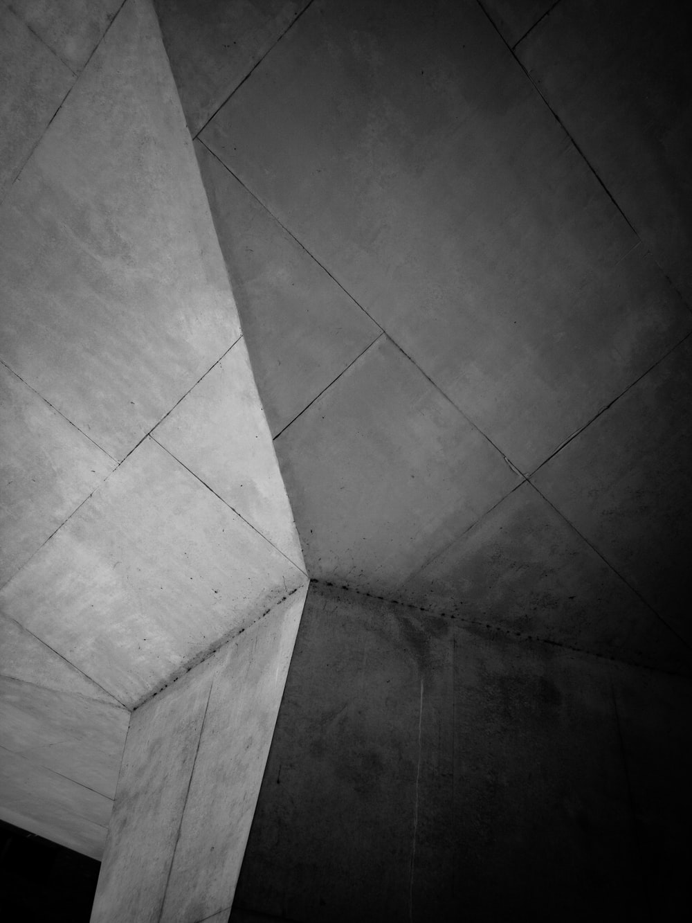 grayscale photo of gray concrete column