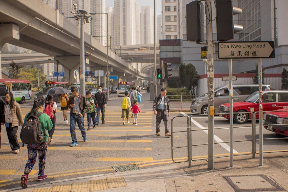 people walking near bridge