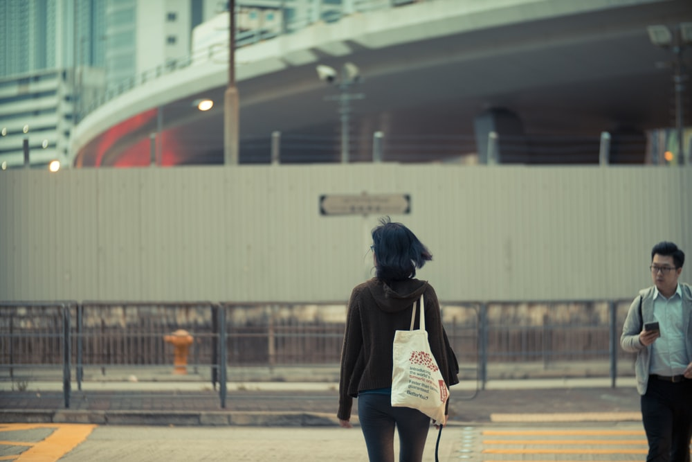 woman carrying white fabric tote bag