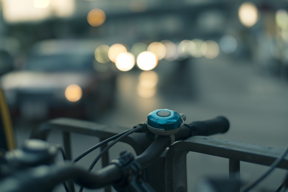 closeup photo of bicycle bell in bokeh photography