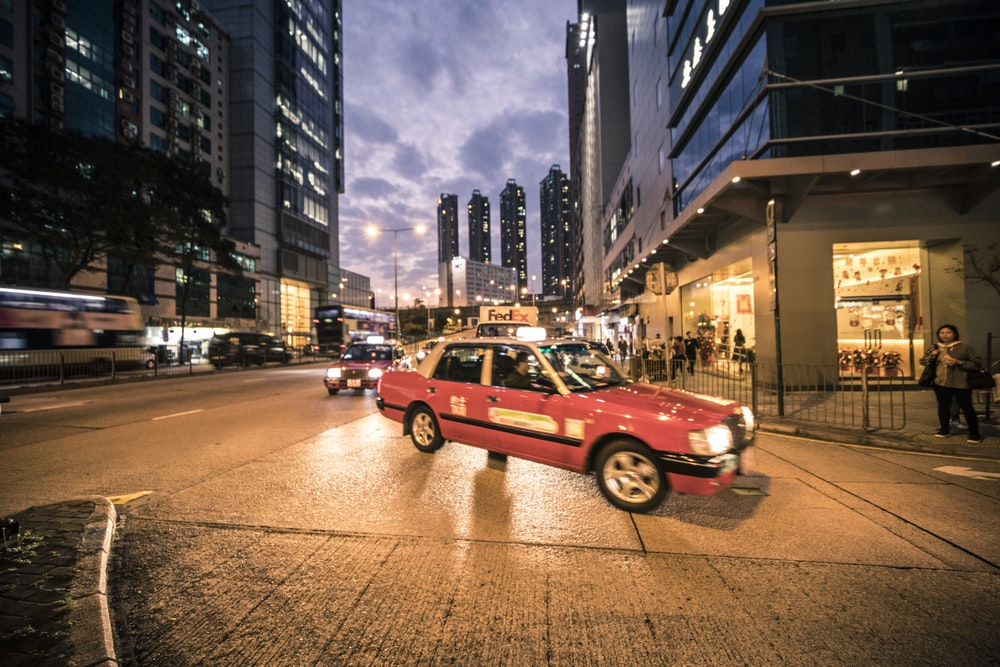 panning photography of vehicles on road