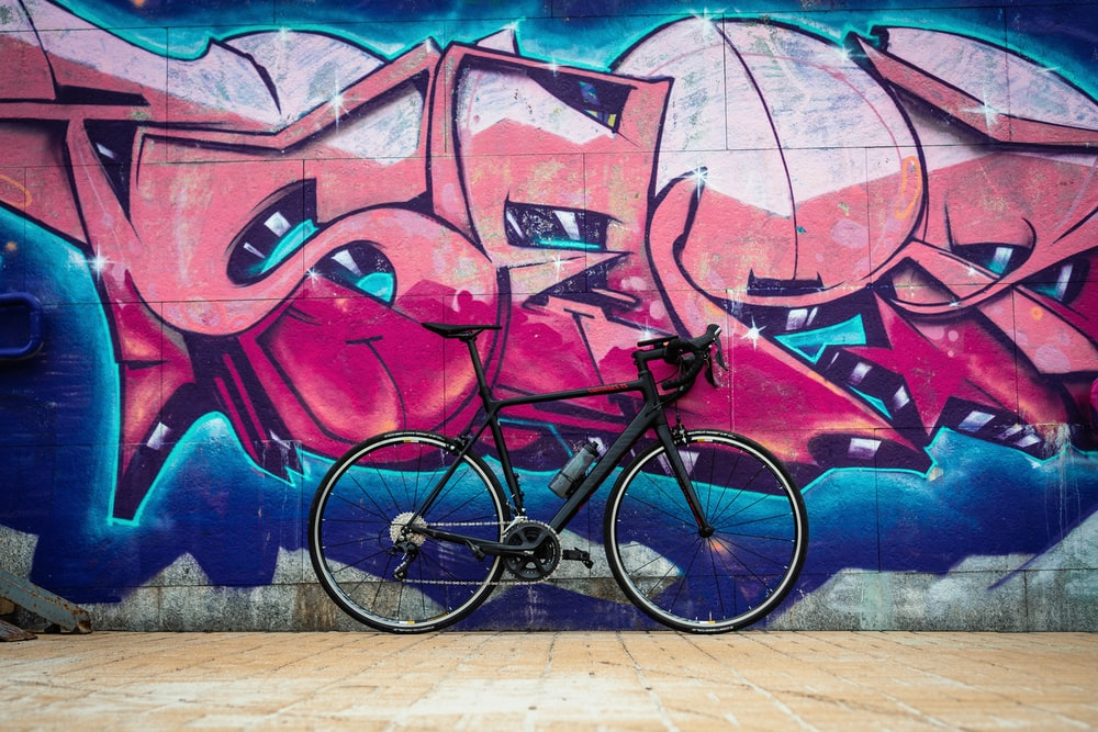 black road bike on wall