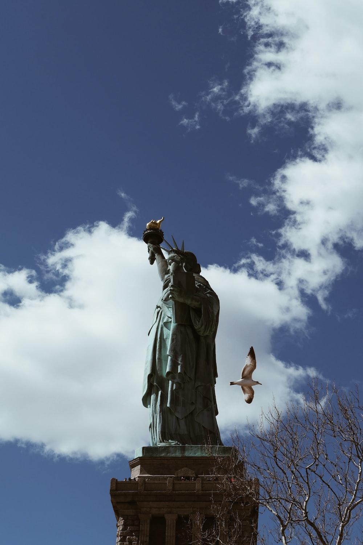 grey statue during daytime