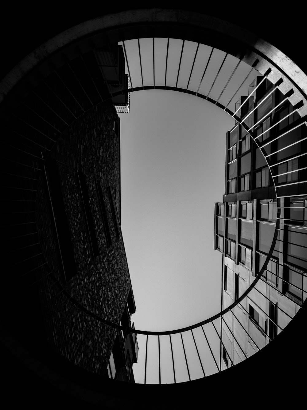 grayscale photography of building low-angle photography