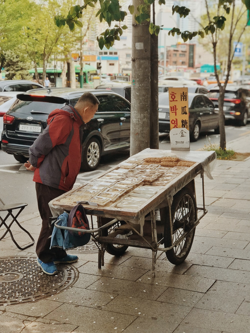 man standing in front of brown cart