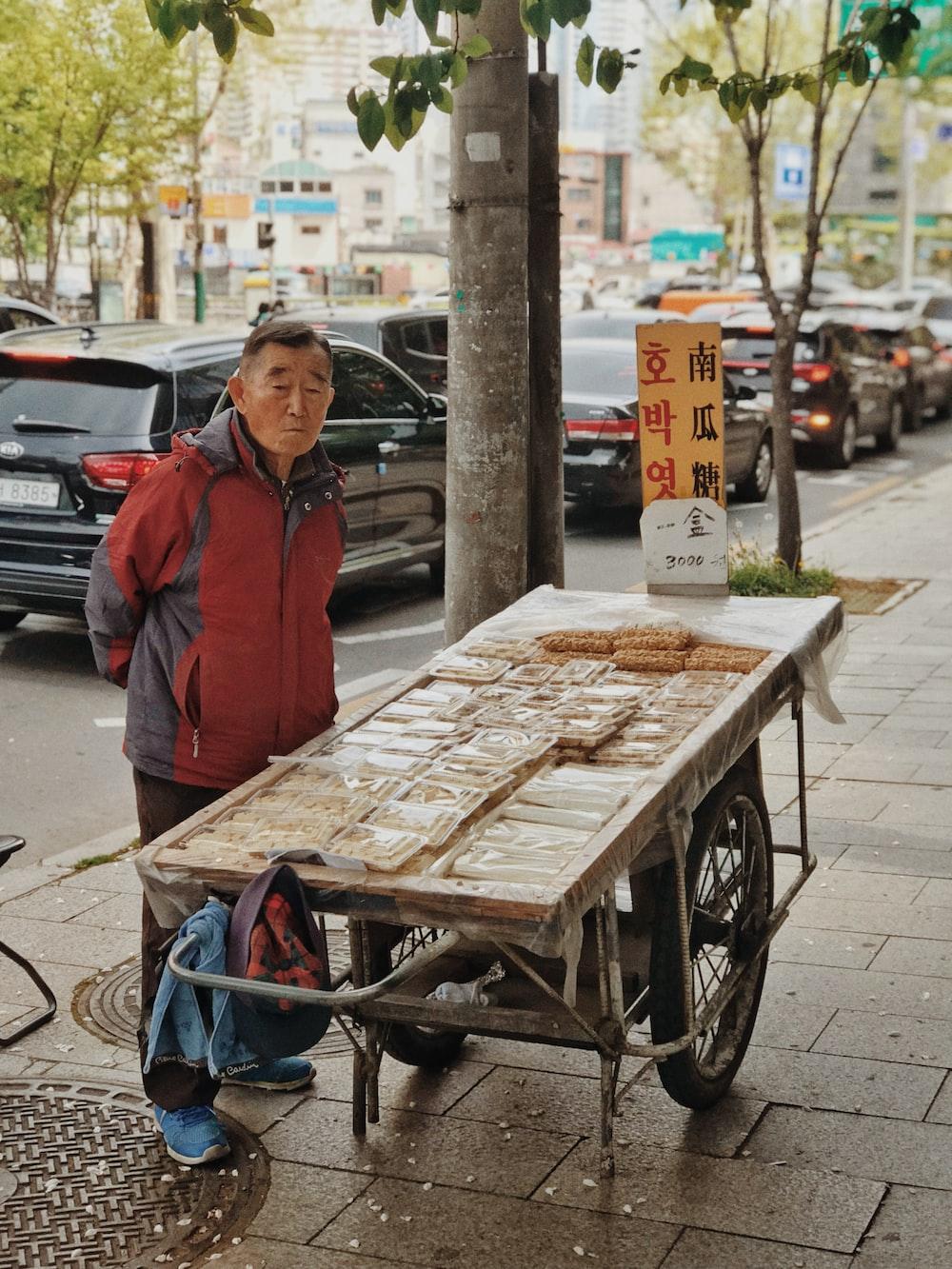 man standing near cart