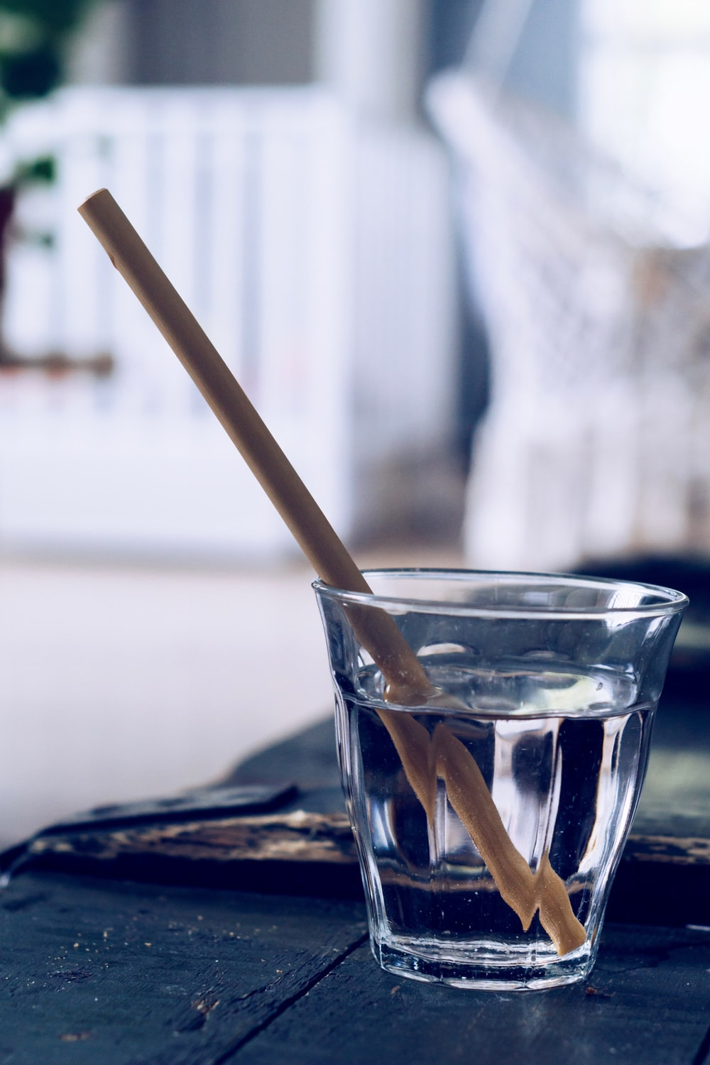 clear drinking glass with brown straw