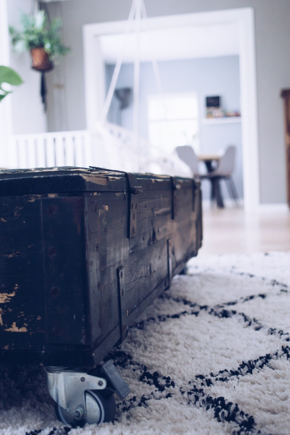 black wooden rolling chest