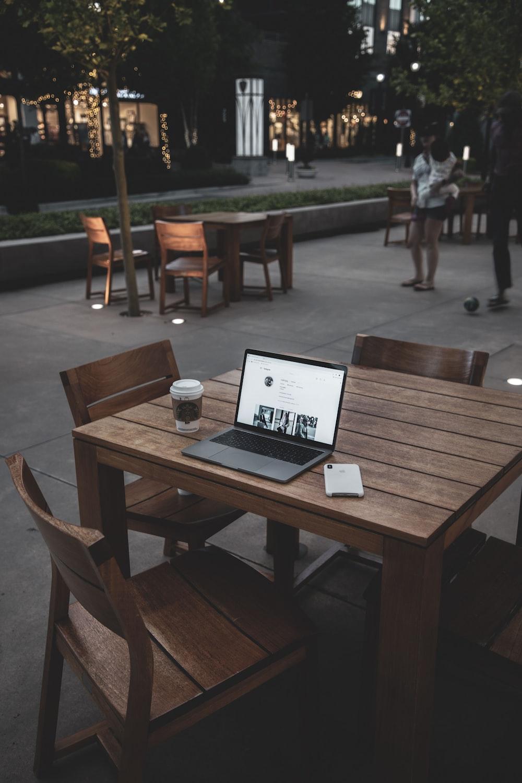 turned-on laptop on table