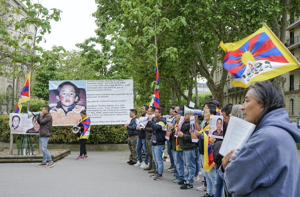 people gathering near poster