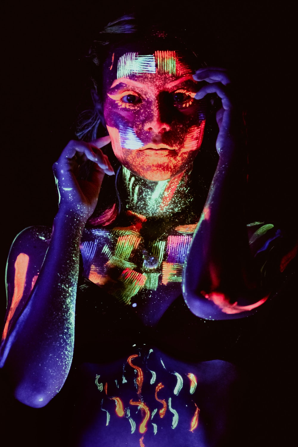 woman with neon paint on face
