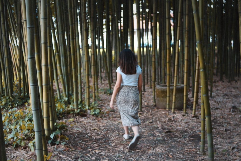 woman walking in bamboo grasses