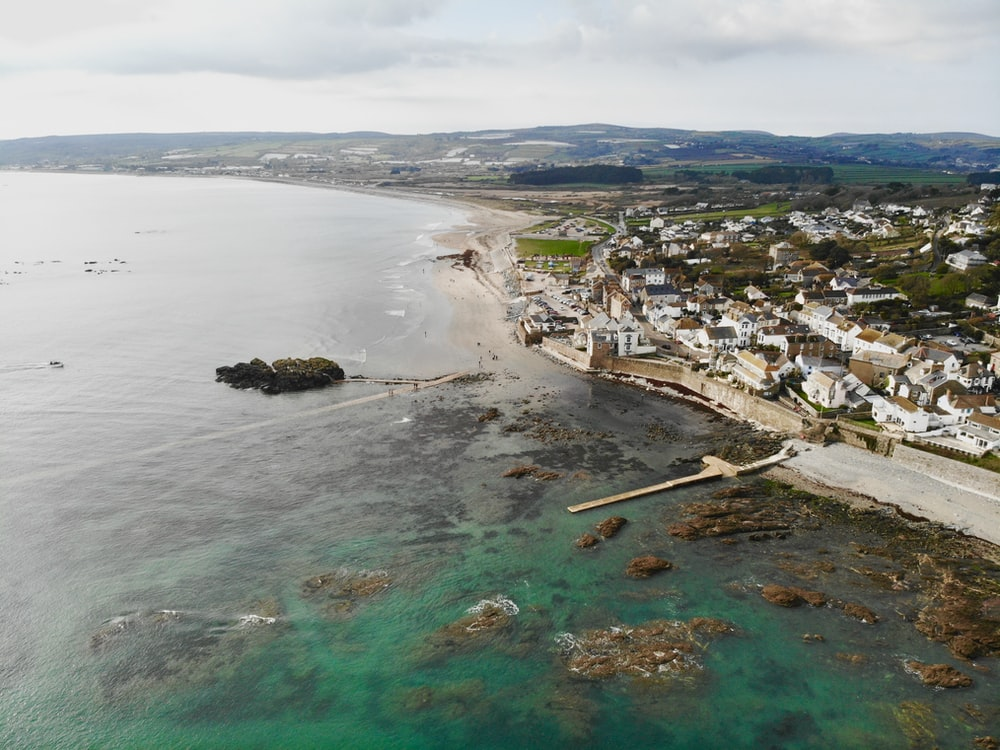 aerial photography of city by the sea