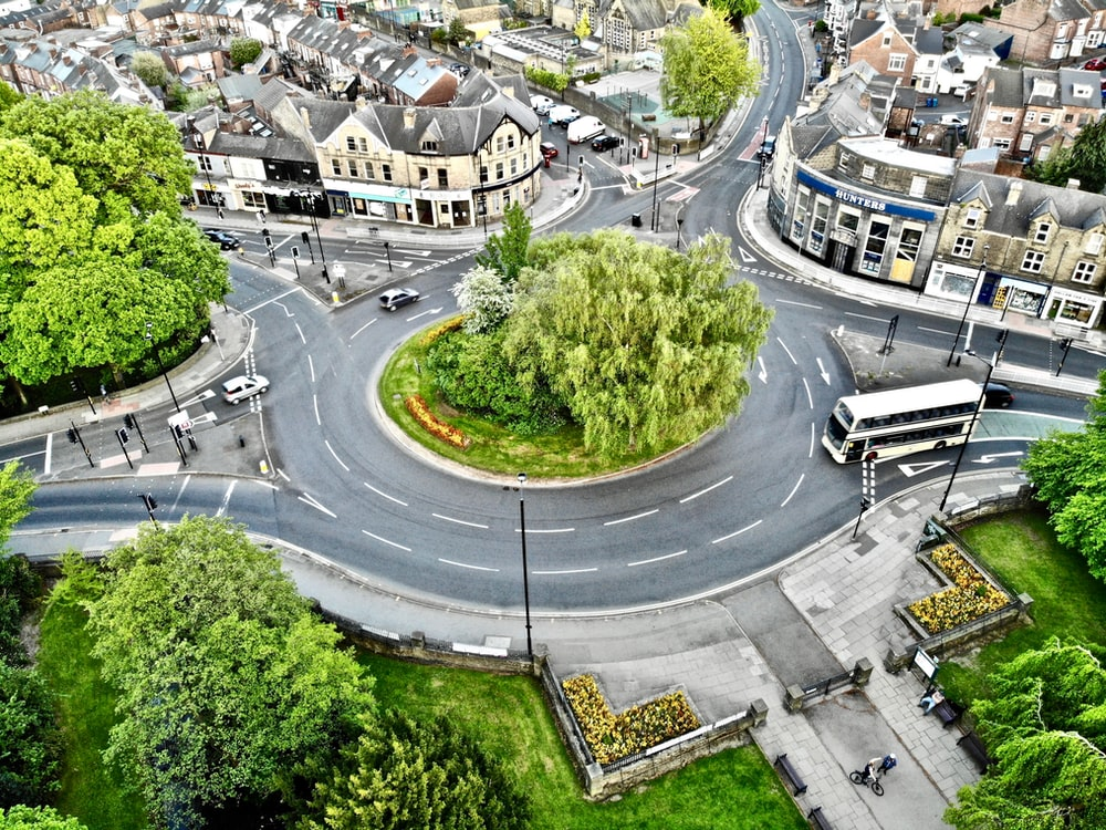 aerial and timelapse photography of vehicles on road during daytime