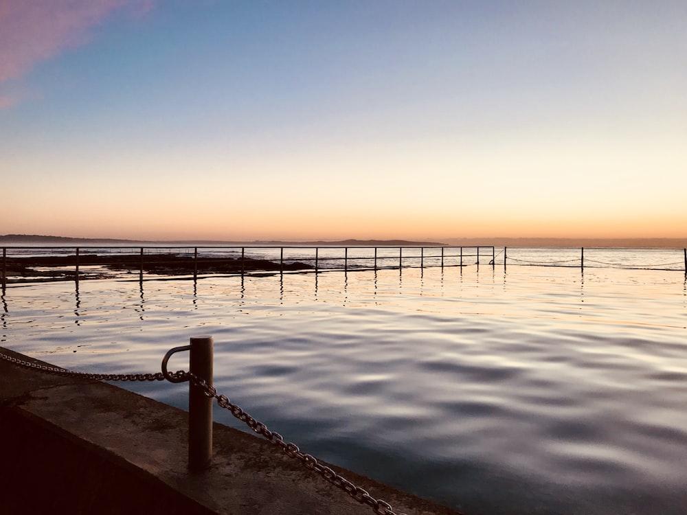 landscape photography of ocean during golden hour