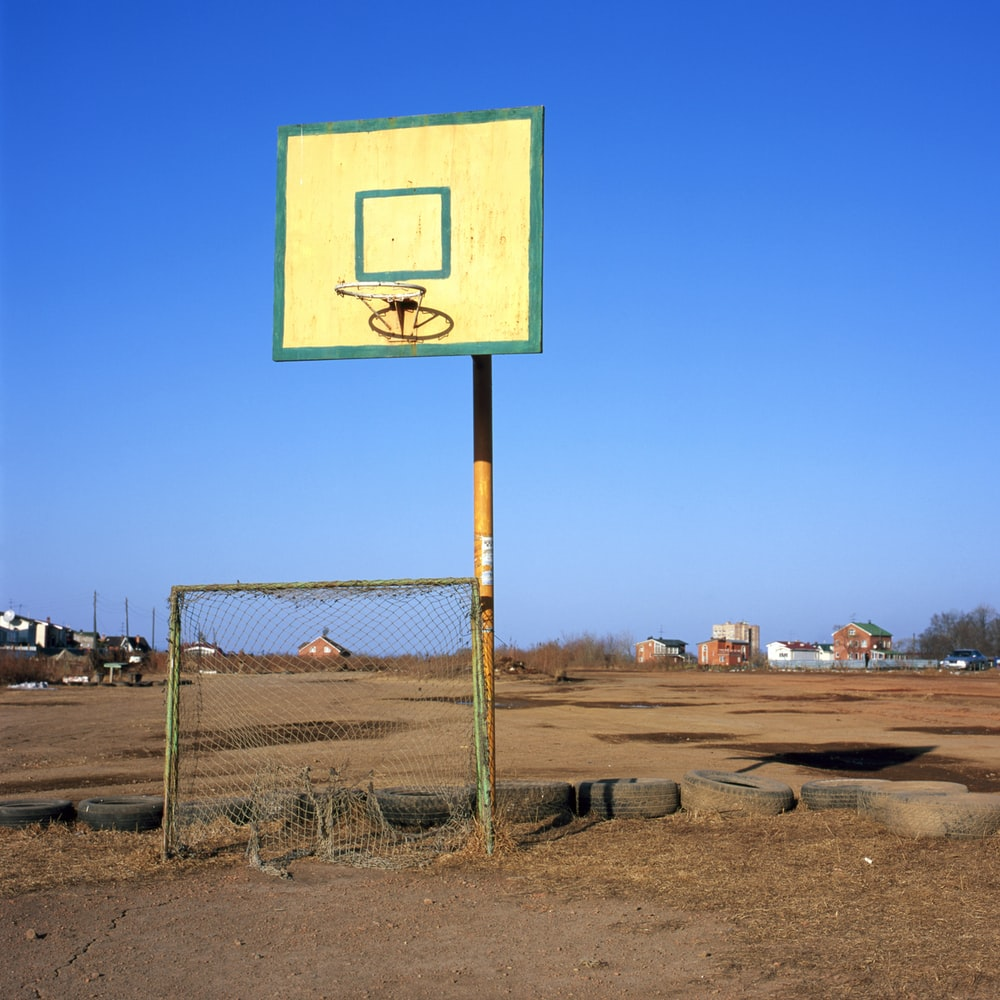 white and teal basketball hoop