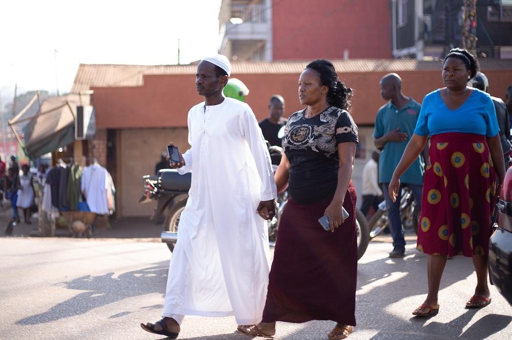 man wearing kurta walking with woman wearing t-shirt