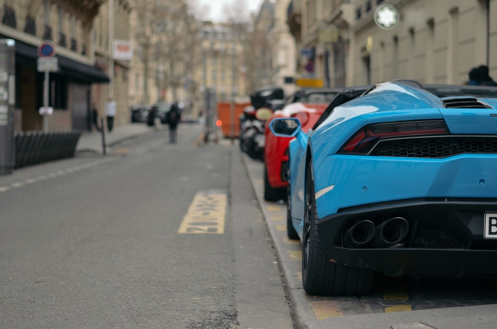 several vehicles parked on sidewalk