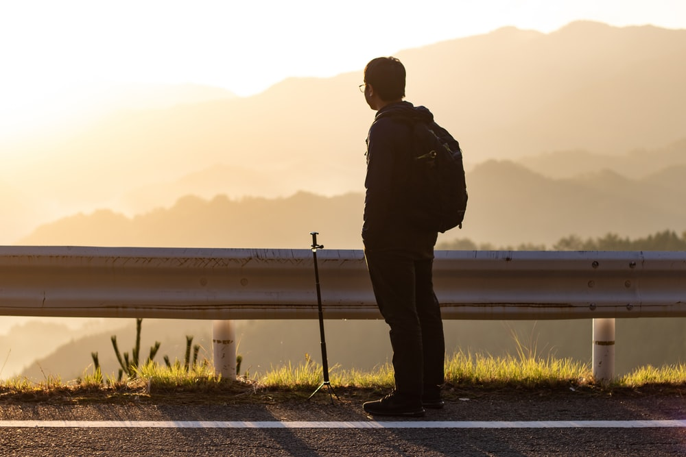 man overlooking mountains during golden hour