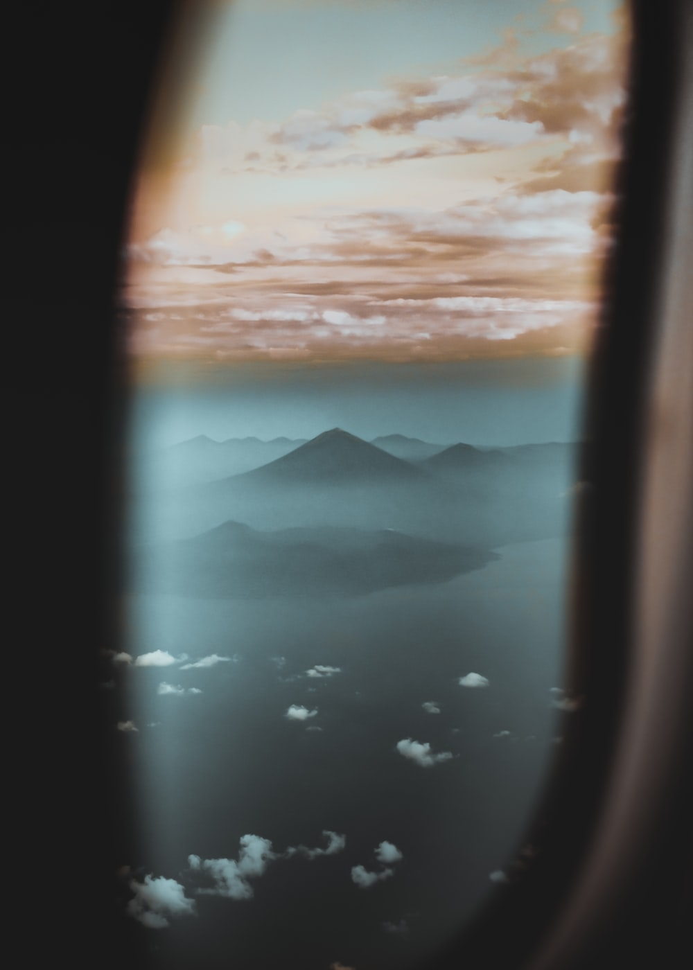 airplane window view of mountains