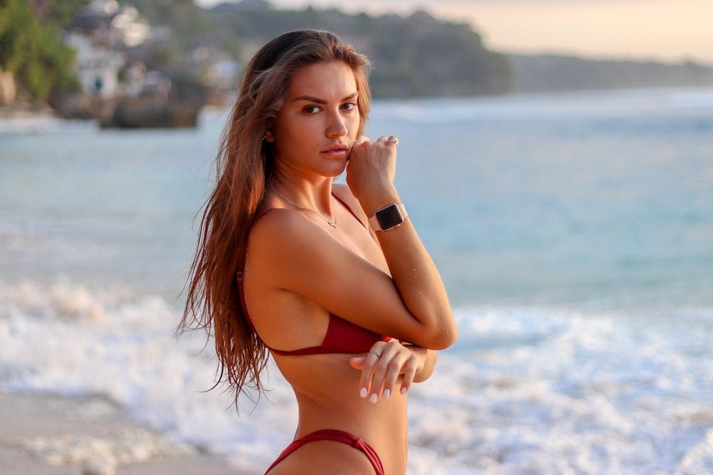 woman wearing red bikini at the beach