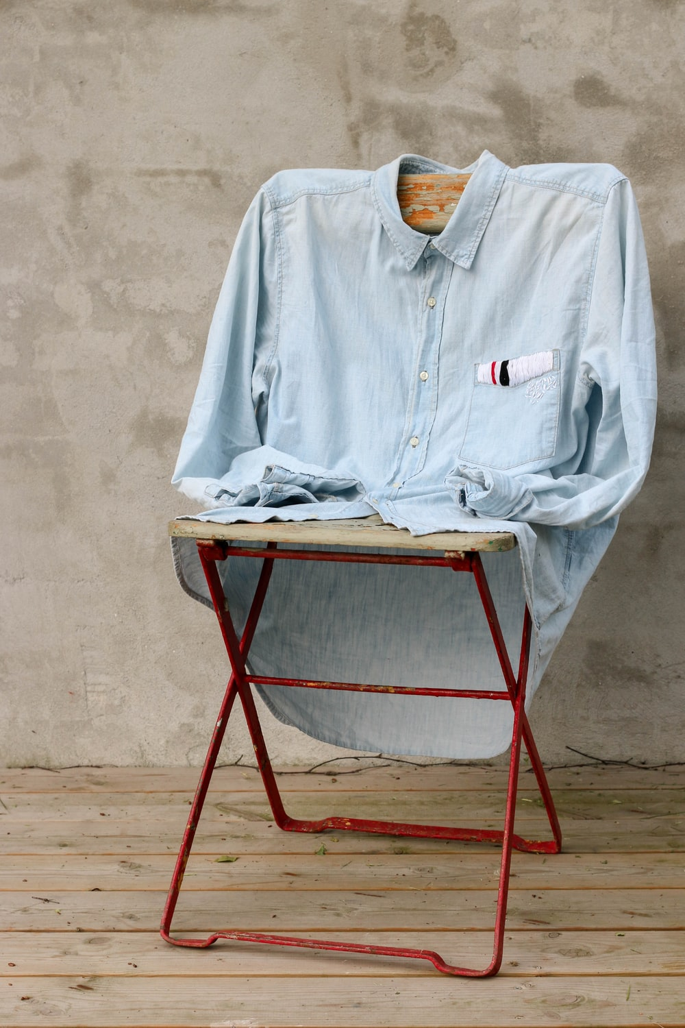 blue dress shirt on chair
