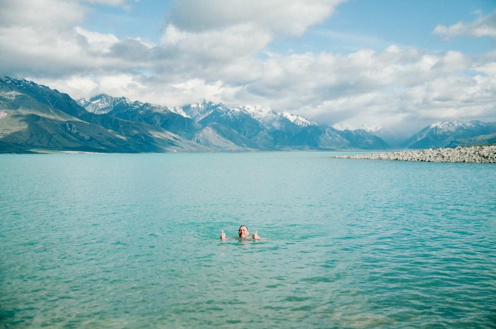 man dipping in ocean