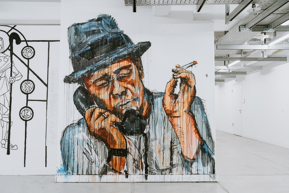 man holding telephone and cigarette painting