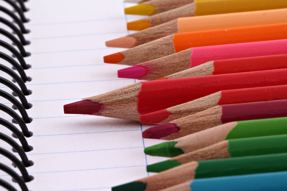 colored pencils on stringed notebook