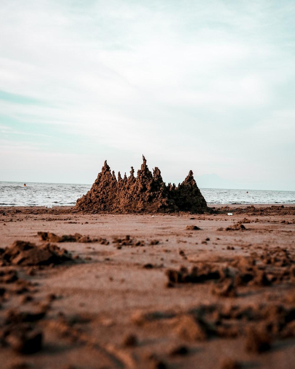 sand castle on seashore during daytime