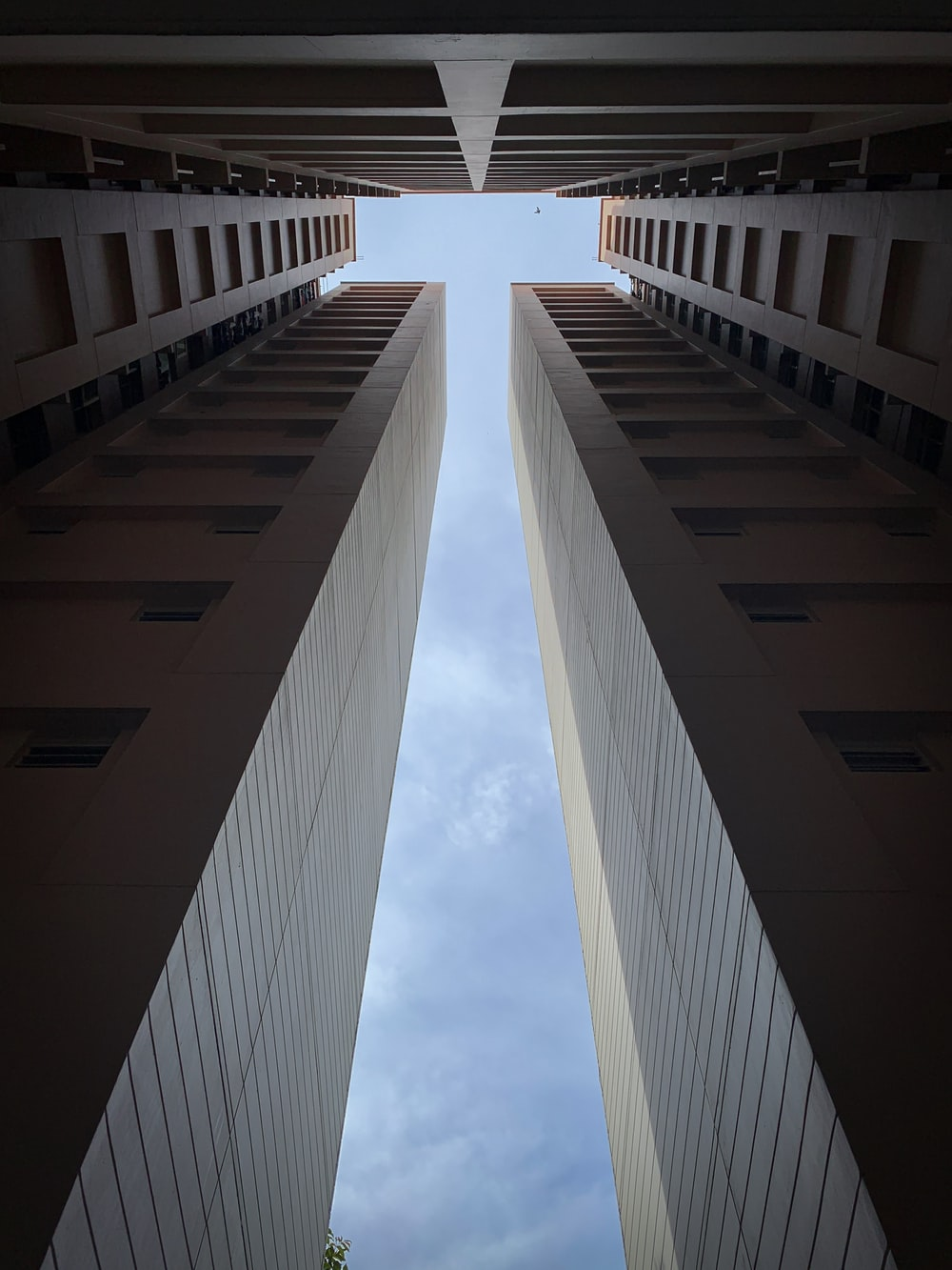 low-angle photo of high-rise buildings under blue sky