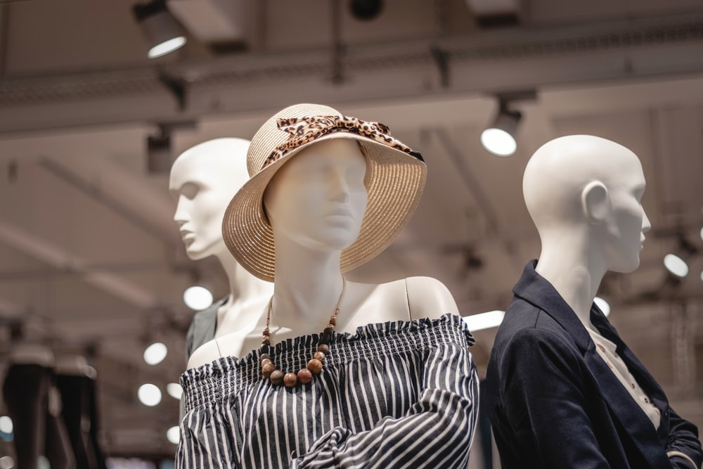 shallow focus photo of mannequin wearing brown sunhat