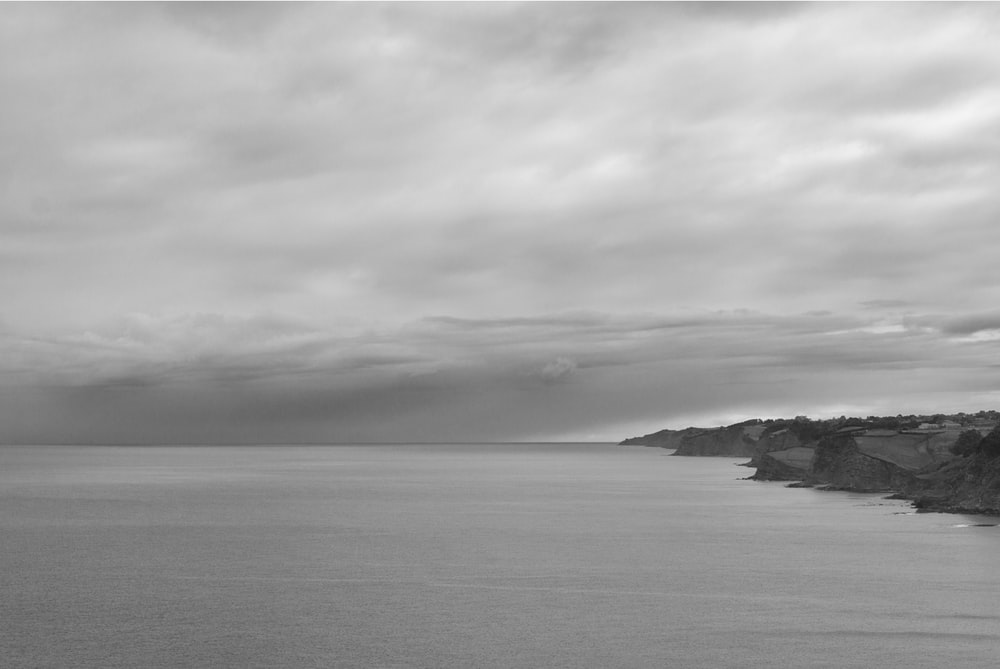 calm sea under gray clouds