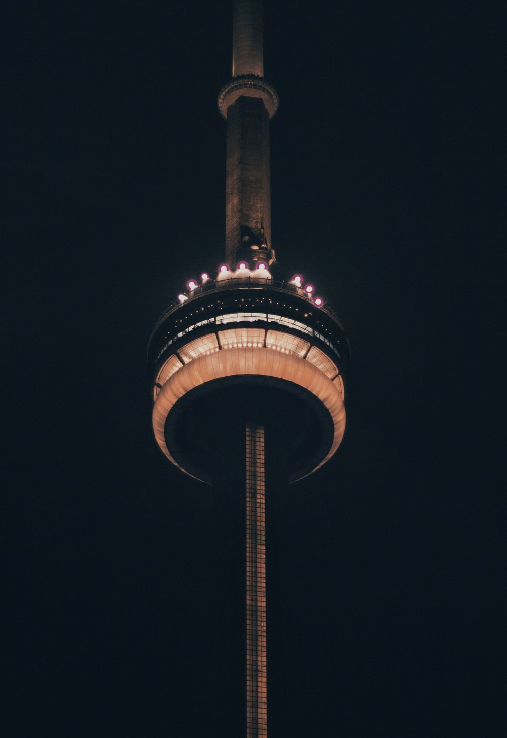 low angle photo of lighted tower