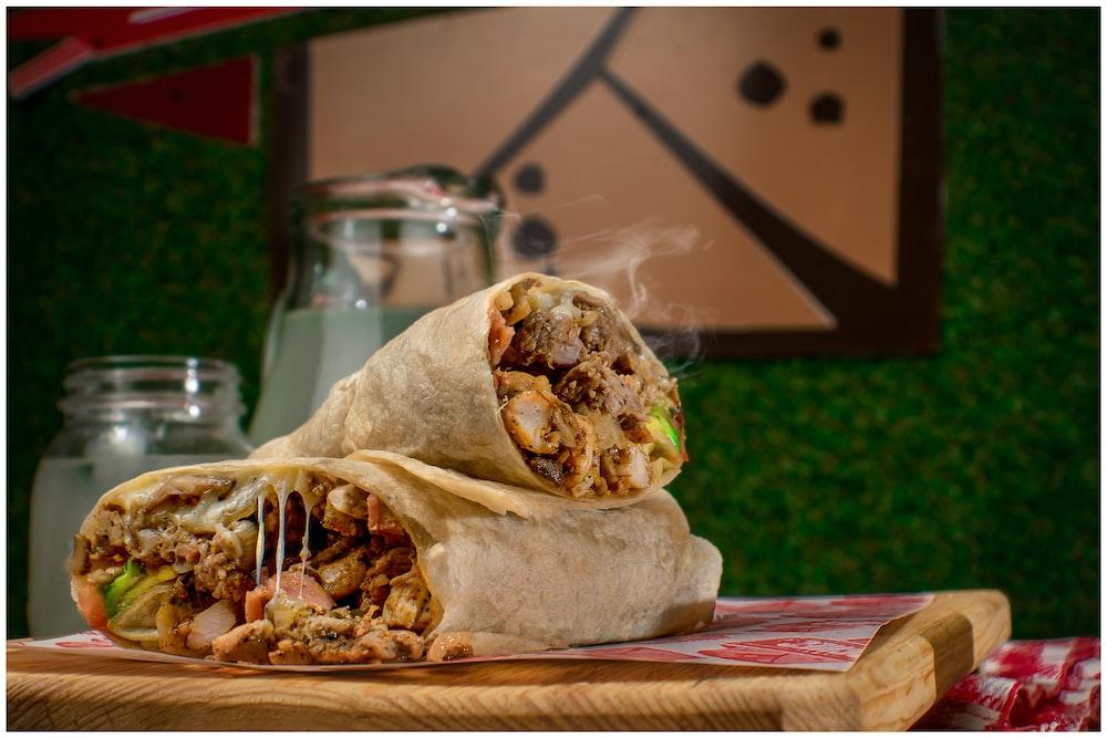 two hot shawarma on chopping board