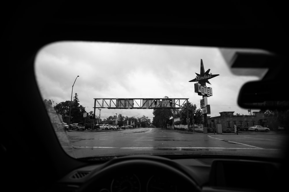 grayscale photo of road sign