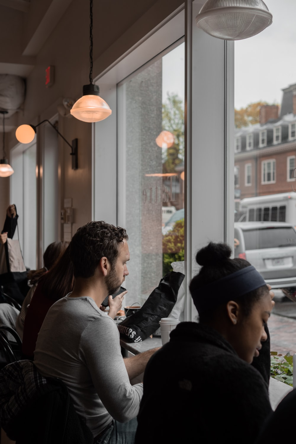 people sits by the table facing windows