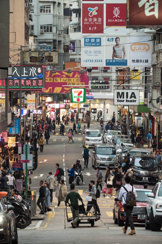 crowd of people walking around city urban road
