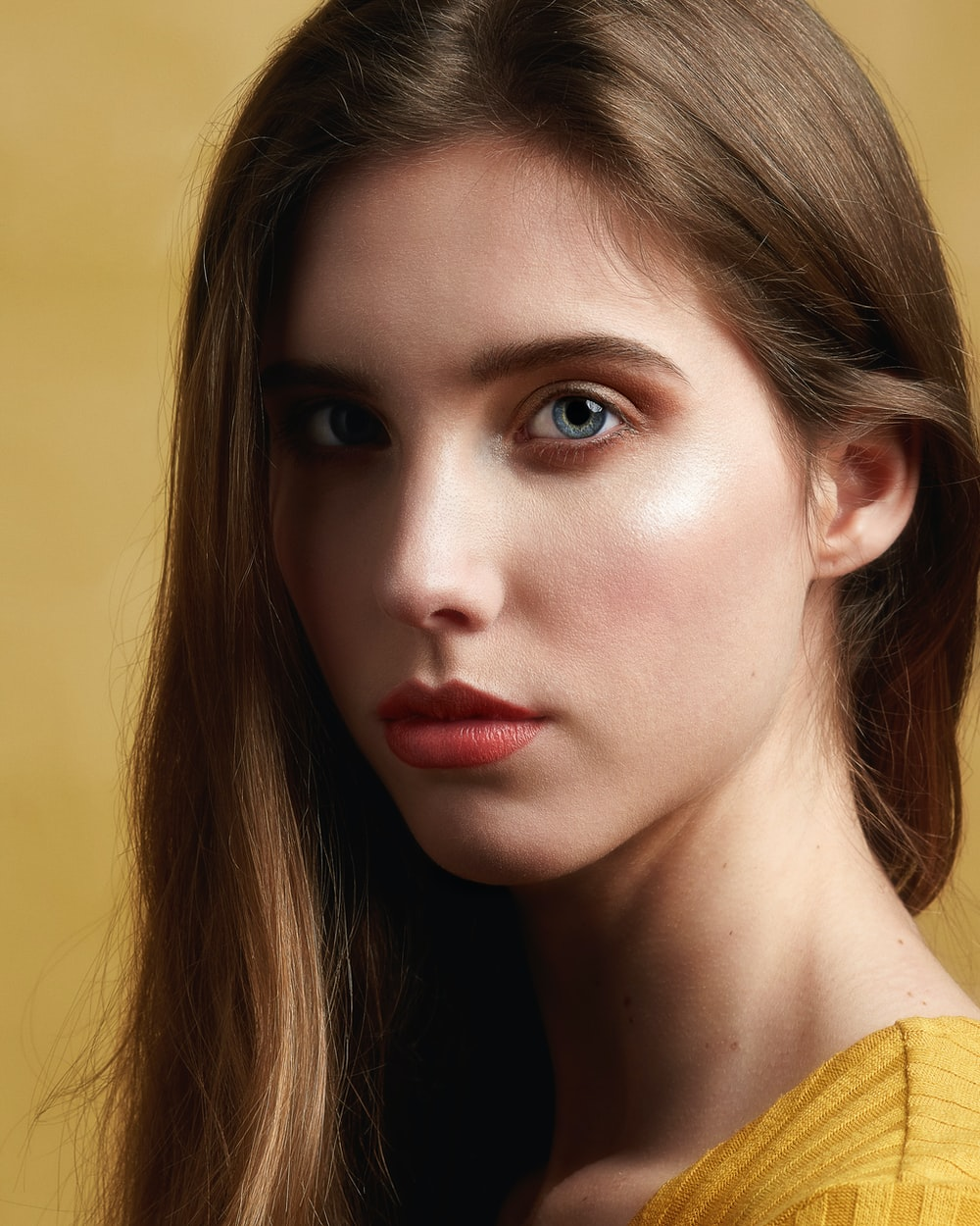 shallow focus photo of woman in yellow top