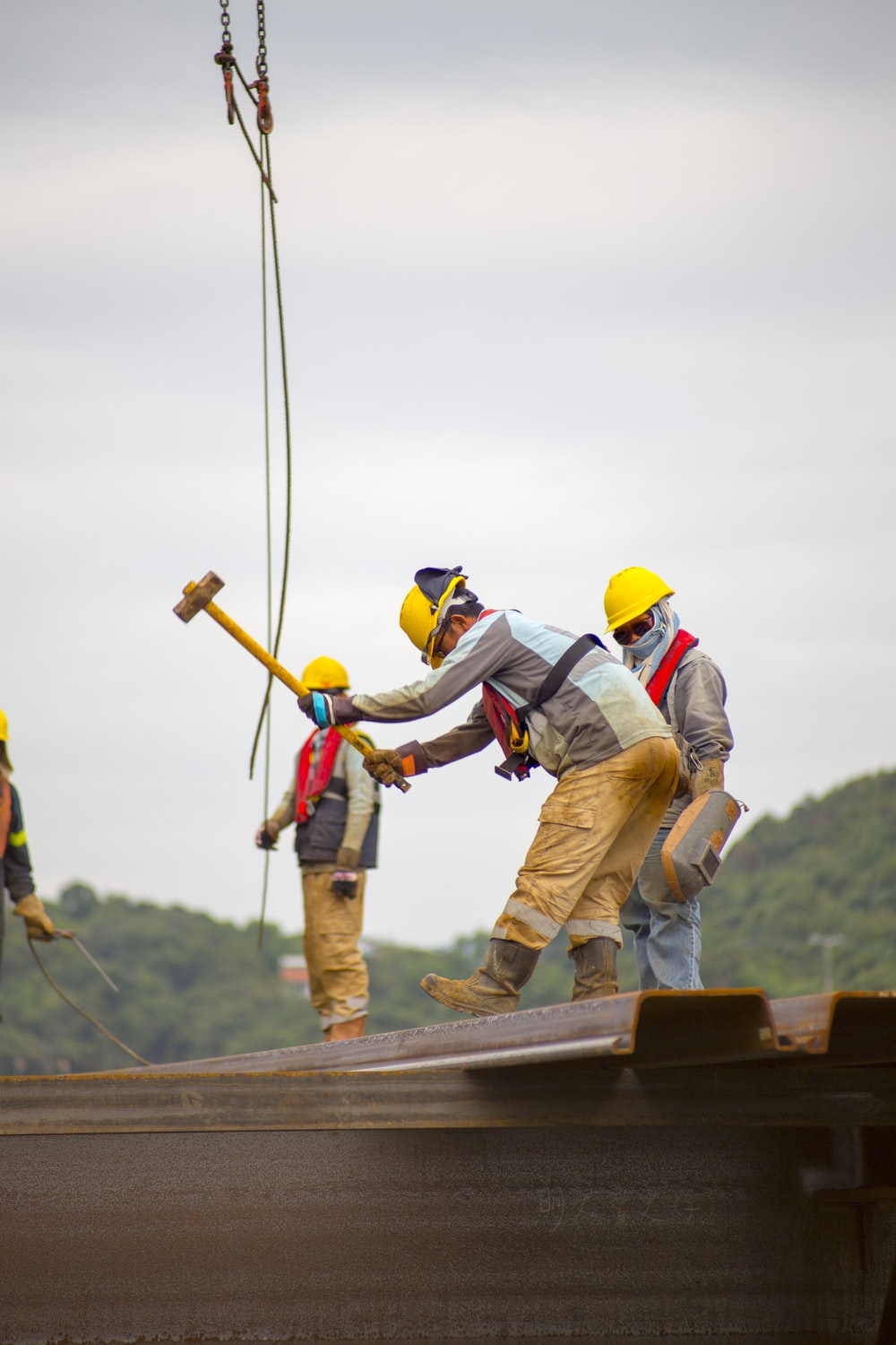 construction worker men holding hammer