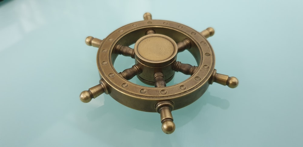 brown metal ship wheel scale model