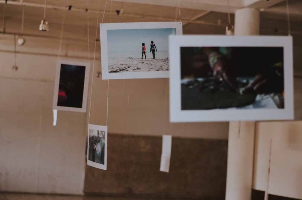 selective focus photography of hanging photos