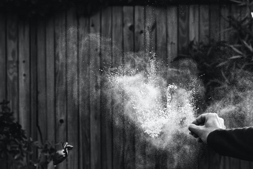 greyscale photography of powder