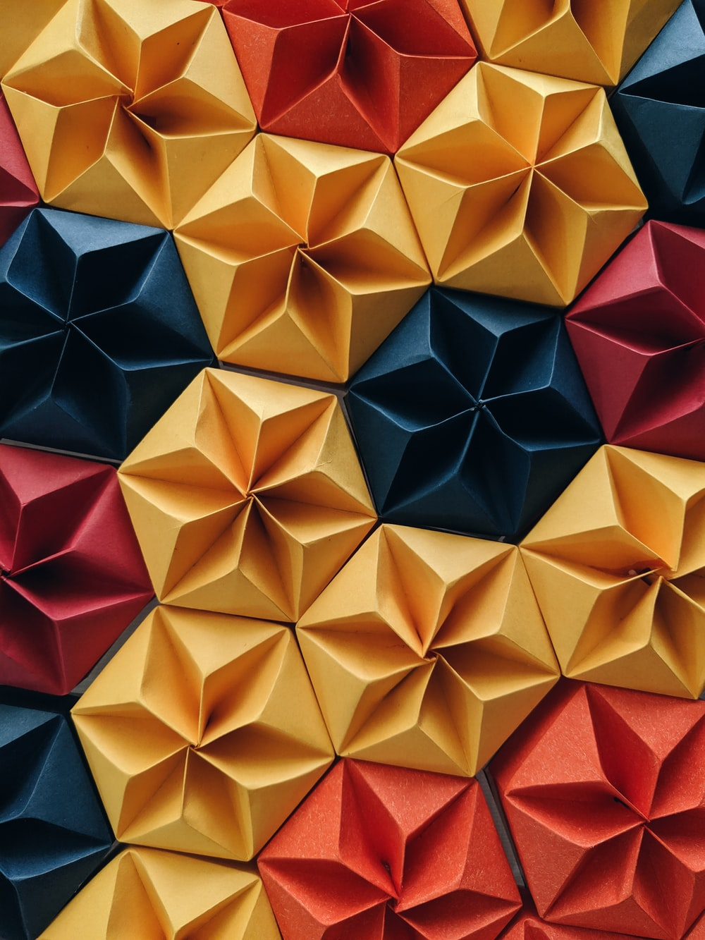 red, yellow, and blue flower origami