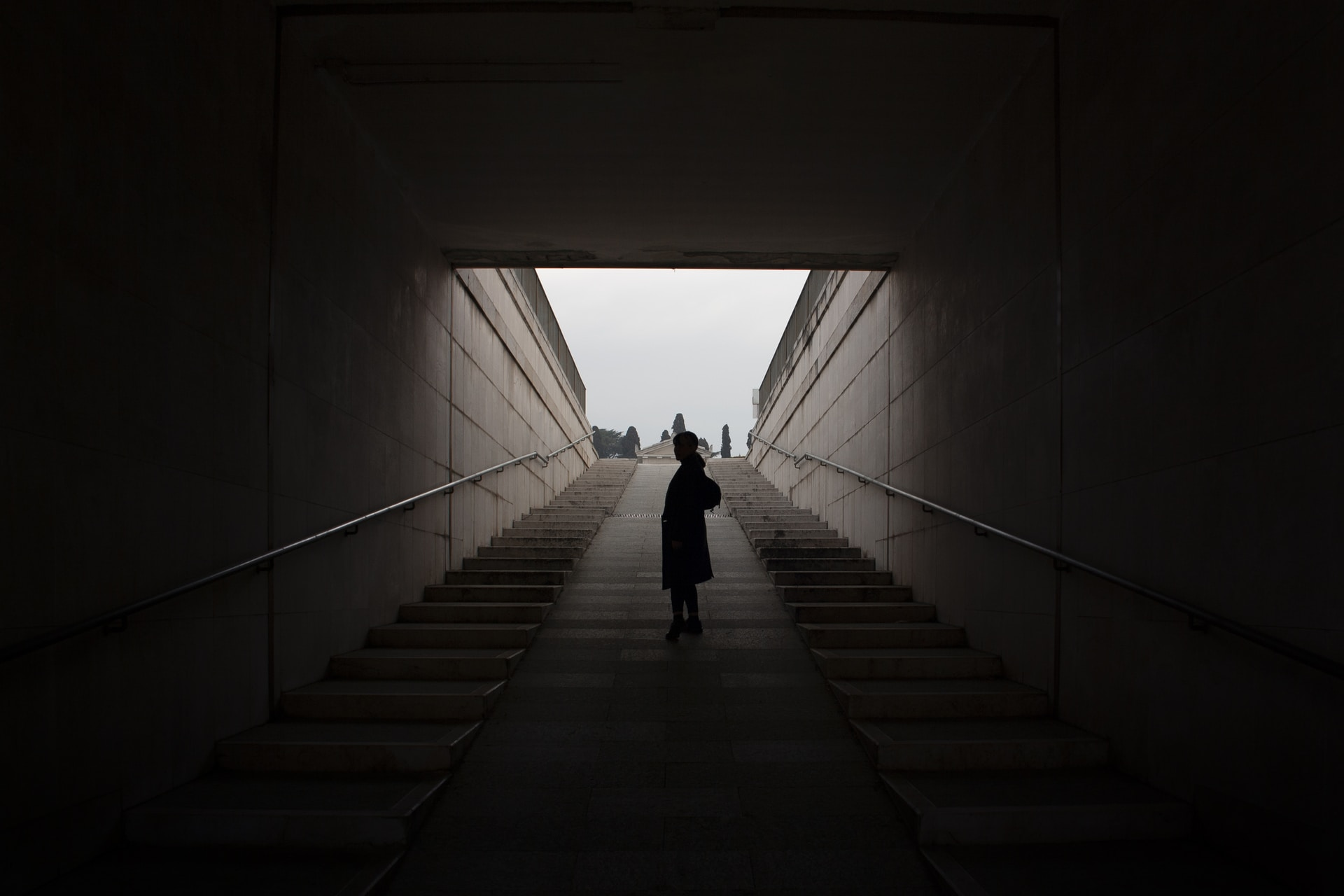 standing person on concrete stairs