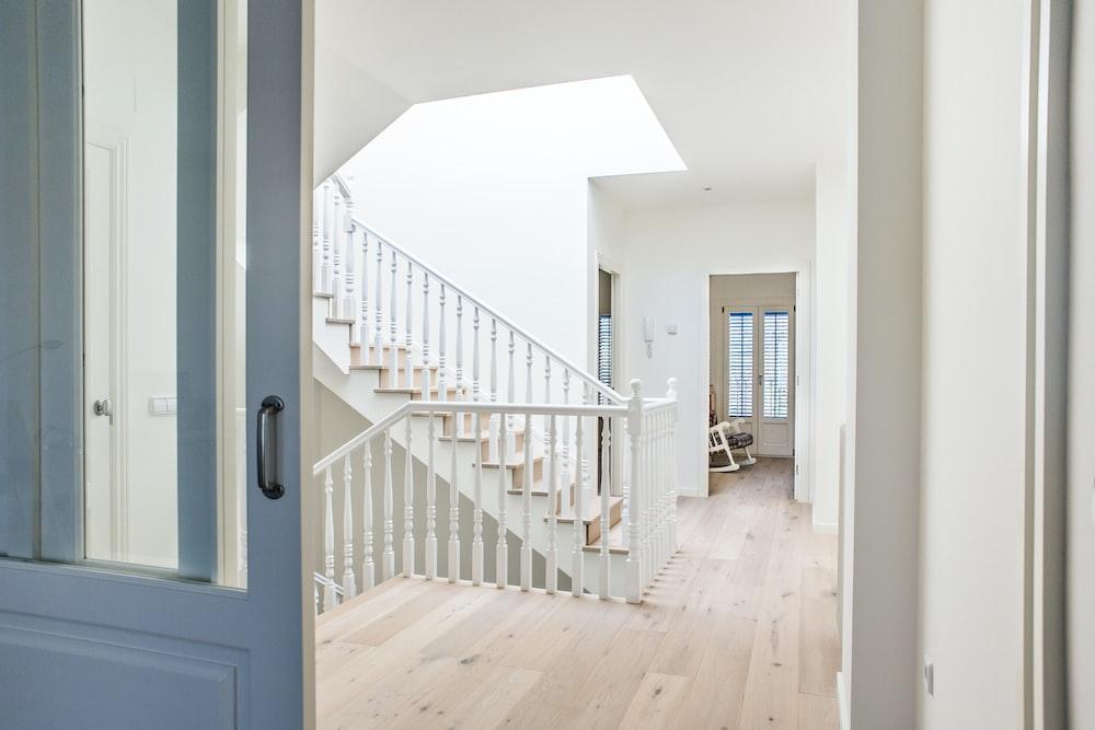 white stairs near door