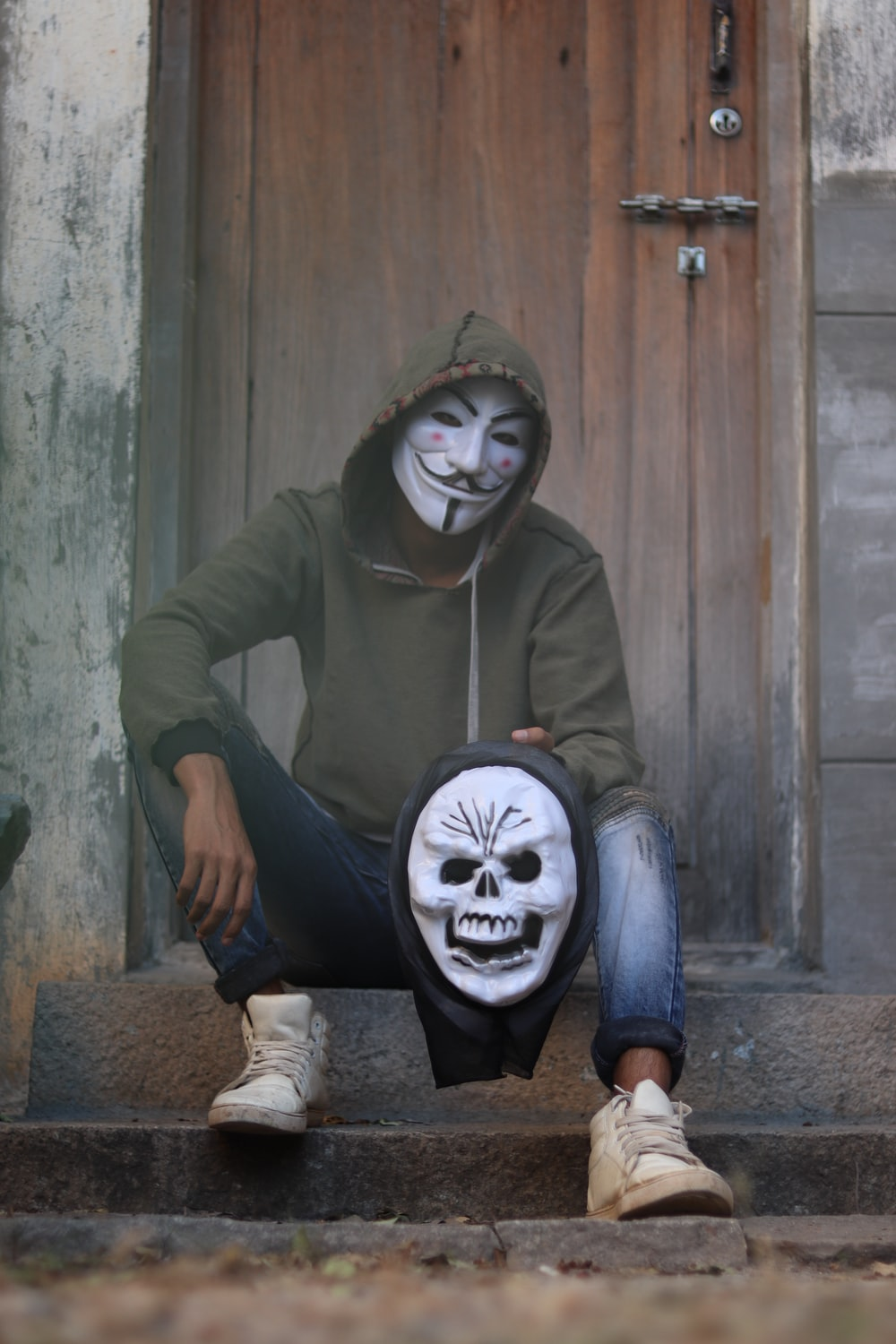 man wearing guy fawkes mask